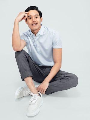 Men's Grey Degree Print Apollo Polo and Medium Grey Kinetic Twill 5-Pocket Pant on model sitting on ground