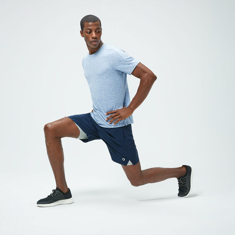 Men's Chambray Blue Composite Merino Active Tee and Navy Newton Active Shorts on model doing a lunge