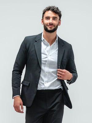 Man wearing Velocity Pant Dark Charcoal, Hybrid Button Down Grey Stripe, Velocity Blazer Dark Charcoal