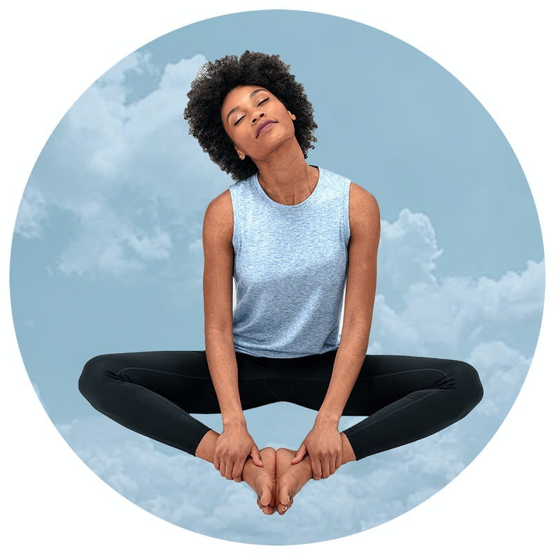 Woman wearing a blue tank top and black leggings sitting on a background of clouds