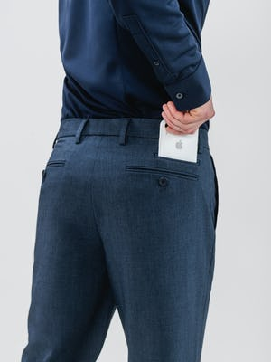 model inserting iphone into stacked rear pocket of men's azurite heather velocity pants
