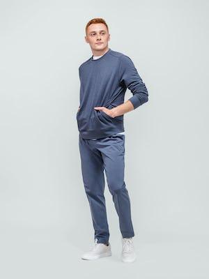 model wearing navy fusion terry sweatshirt and indigo heather kinetic jogger facing forward hands in kangaroo pocket