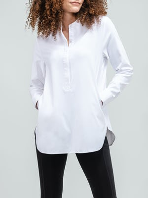 women's white aero zero band collar tunic zoomed shot of model facing forward with hands in pockets