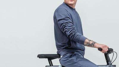 model on bike wearing fusion terry sweatshirt
