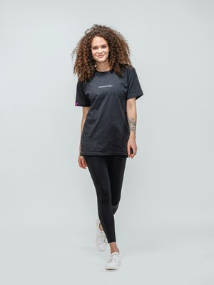 female model wearing charcoal heather science for better tee and joule active legging walking forward