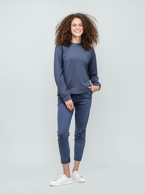 Women's Navy Fusion Terry Sweatshirt and Women's Indigo Heather Kinetic Pull On Pant on model standing forward with hand in pocket