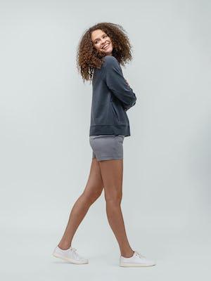 Women's Navy Fusion Terry Sweatshirt and Women's Grey Momentum Chino Short on model walking forward