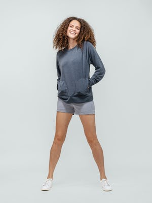 Women's Navy Fusion Terry Sweatshirt and Women's Grey Momentum Chino Short on model with hands in pockets