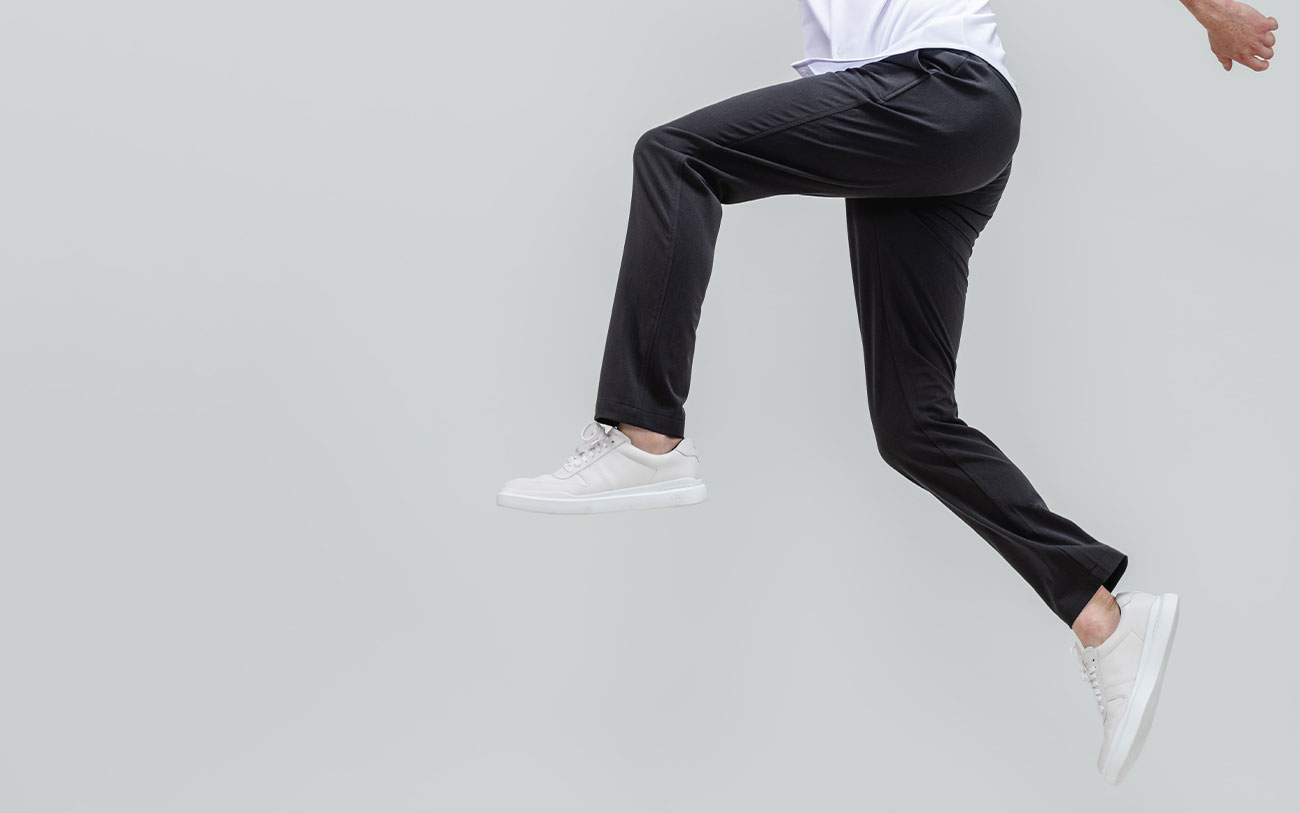 men's black pace tapered chino model leaping forward