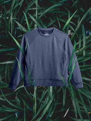 women's navy fusion terry sweatshirt flat shot of front on a bed of grass