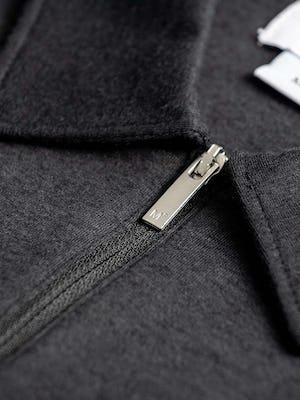 men's black composite merino zip polo zoomed shot of branded zipper