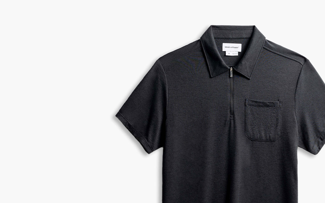 close up of black composite merino zip polo