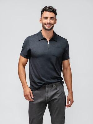 model wearing black composite merino zip polo and dark grey chroma denim facing forward