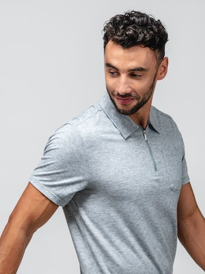 close up of model wearing pale grey heather composite merino zip polo facing sideways