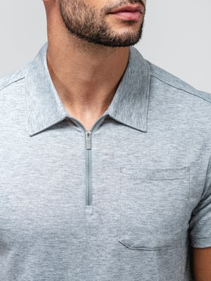 close up of model wearing pale grey heather composite merino zip polo