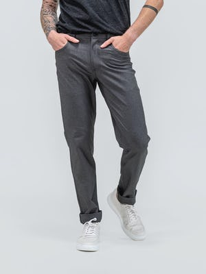 male model wearing charcoal heather science for better tee and grey kinetic twill 5 pocket pant facing forward with hands in pockets