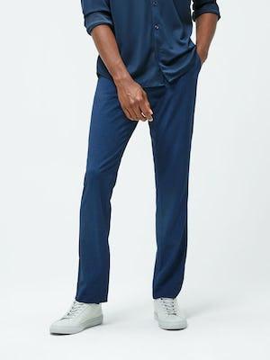 Men's Navy Recycled Apollo Shirt and Men's Indigo Heather Velocity Pant on model facing forward