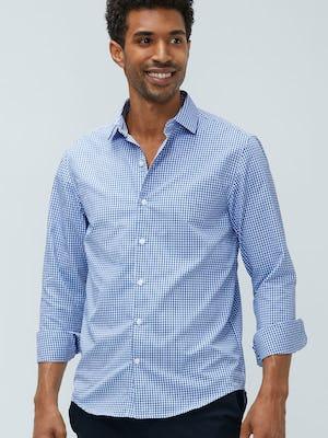 man's blue box plaid aero zero dress shirt model facing forward sleeves rolled