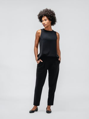Black Swift Sheath Tank and Swift Drape Pant on model facing forward with hands in pockets