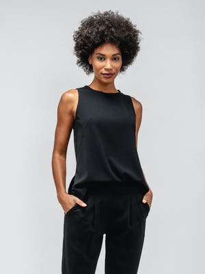 Black Swift Sheath Tank on model standing forward with hands in pockets