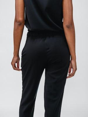 Close up of the back of Black Women's Swift Drape Pant on model