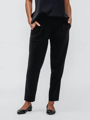 Women's Black Swift Drape Pant on model with hands in pockets