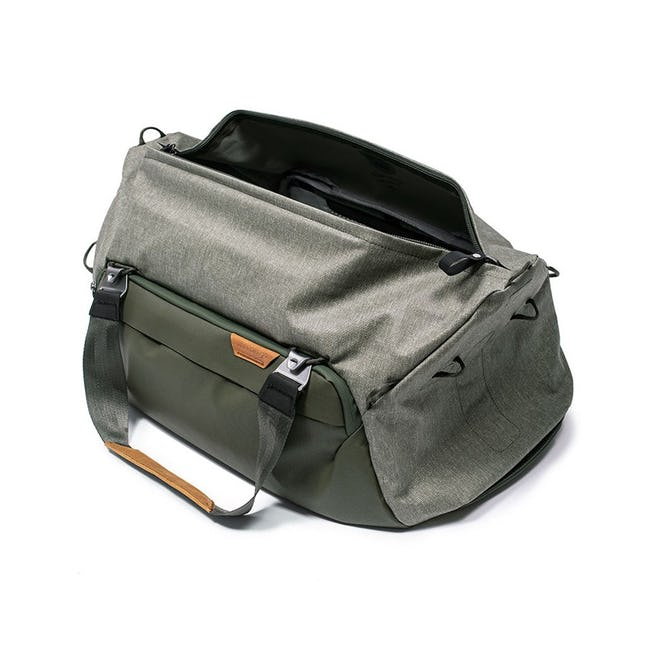 Image of a green duffel bag with one side open