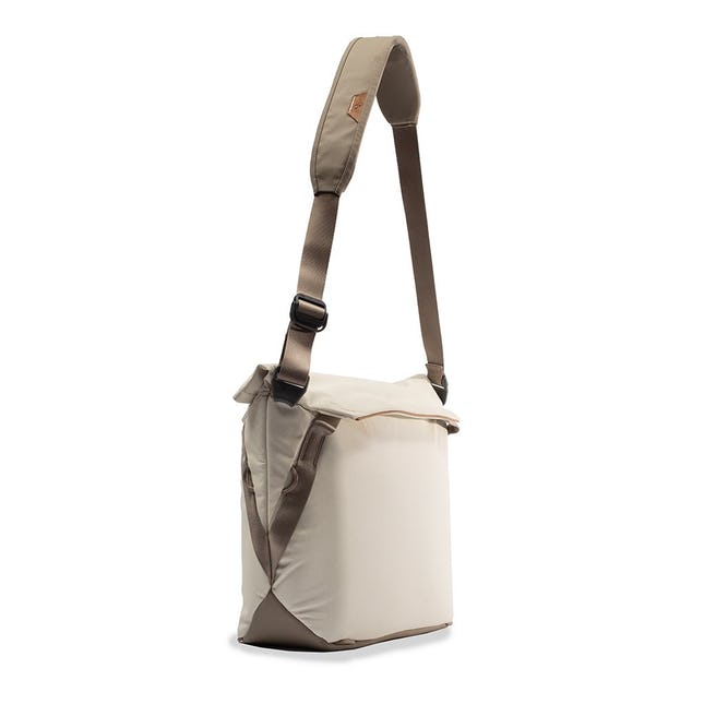 Image of a tan colored tote bag from the side
