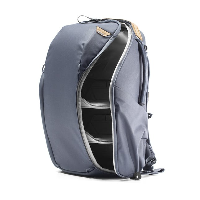 Image of a midnight blue backpack with the side zipper open