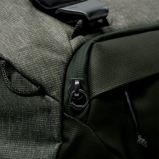 Close up of green duffel bag zipper features