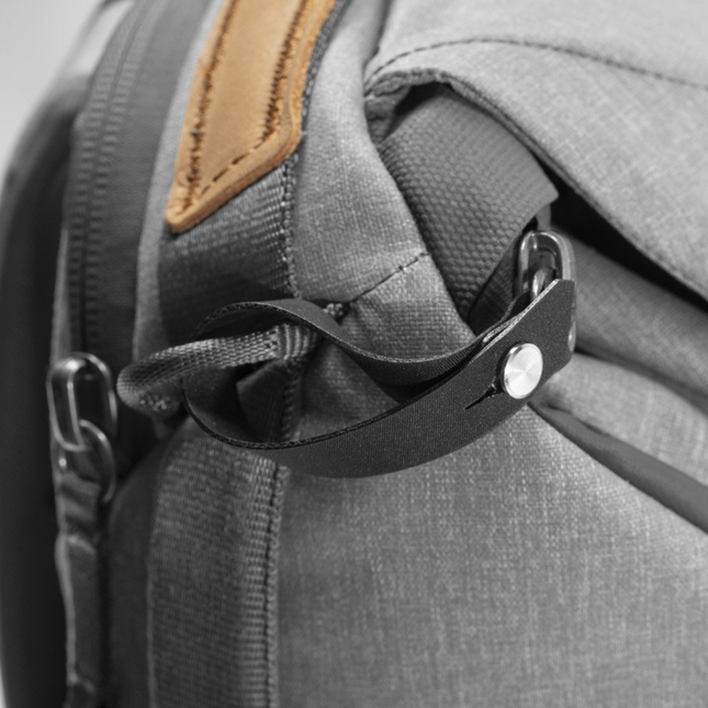 Close up image of a charcoal grey backpack zipper