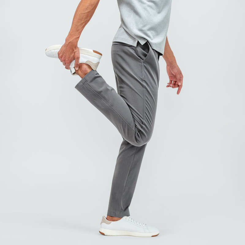 Man standing on one leg, bending his right knee