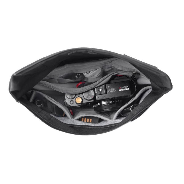 Image of a small black pouch open with a camera inside of it