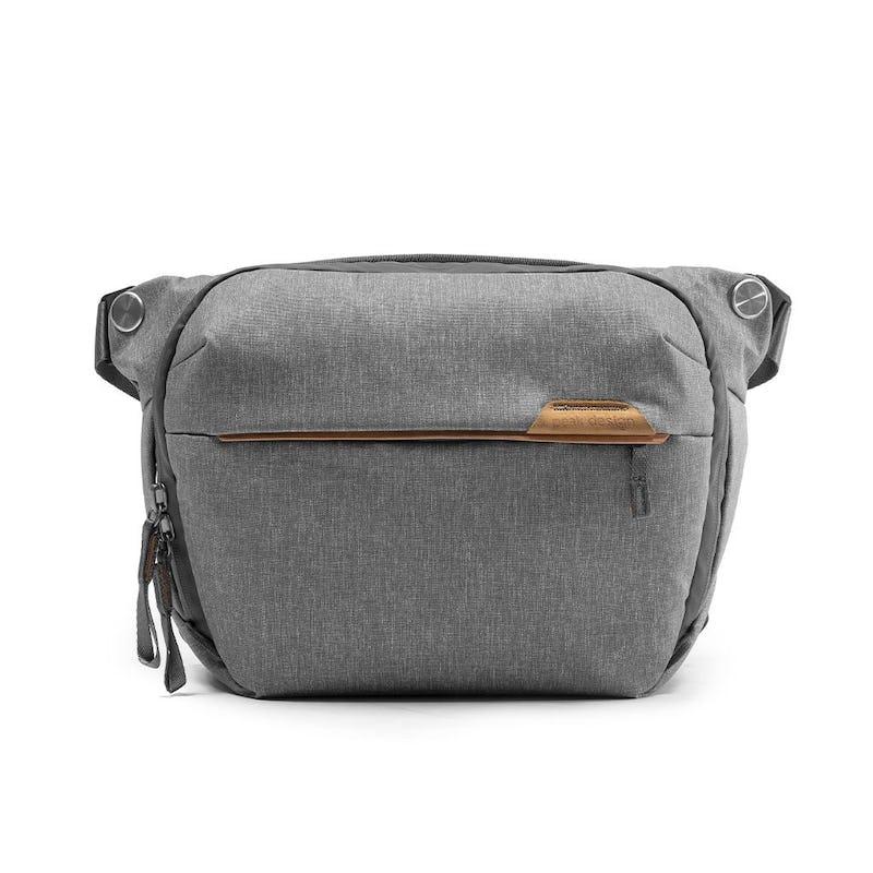 Image of a grey crossbody bag