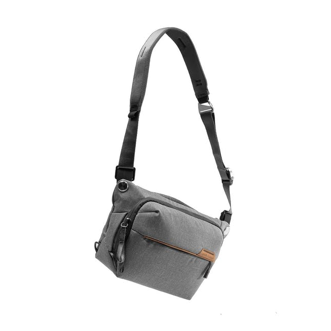 Closeup Image of a grey crossbody bag with the long strap attached
