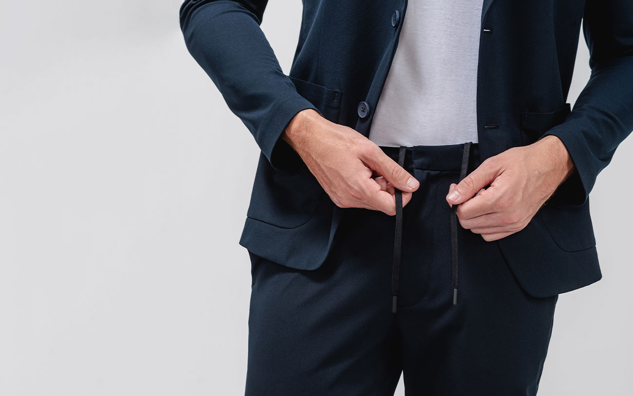 model adjusting kinetic tapered pant waistband drawcord