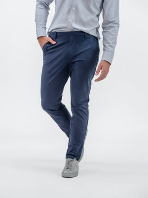 model wearing grey heather houndstooth aero button down and slate blue kinetic tapered pant walking forward with hand in pocket