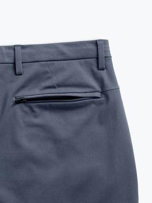 men's slate blue kinetic tapered pant zoomed shot of rear zip pocket