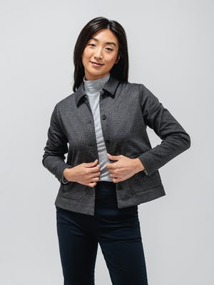 model wearing charcoal heather fusion chore coat and grey heather composite merino mock neck and black kinetic pull on pant with chore coat unbuttoned facing camera