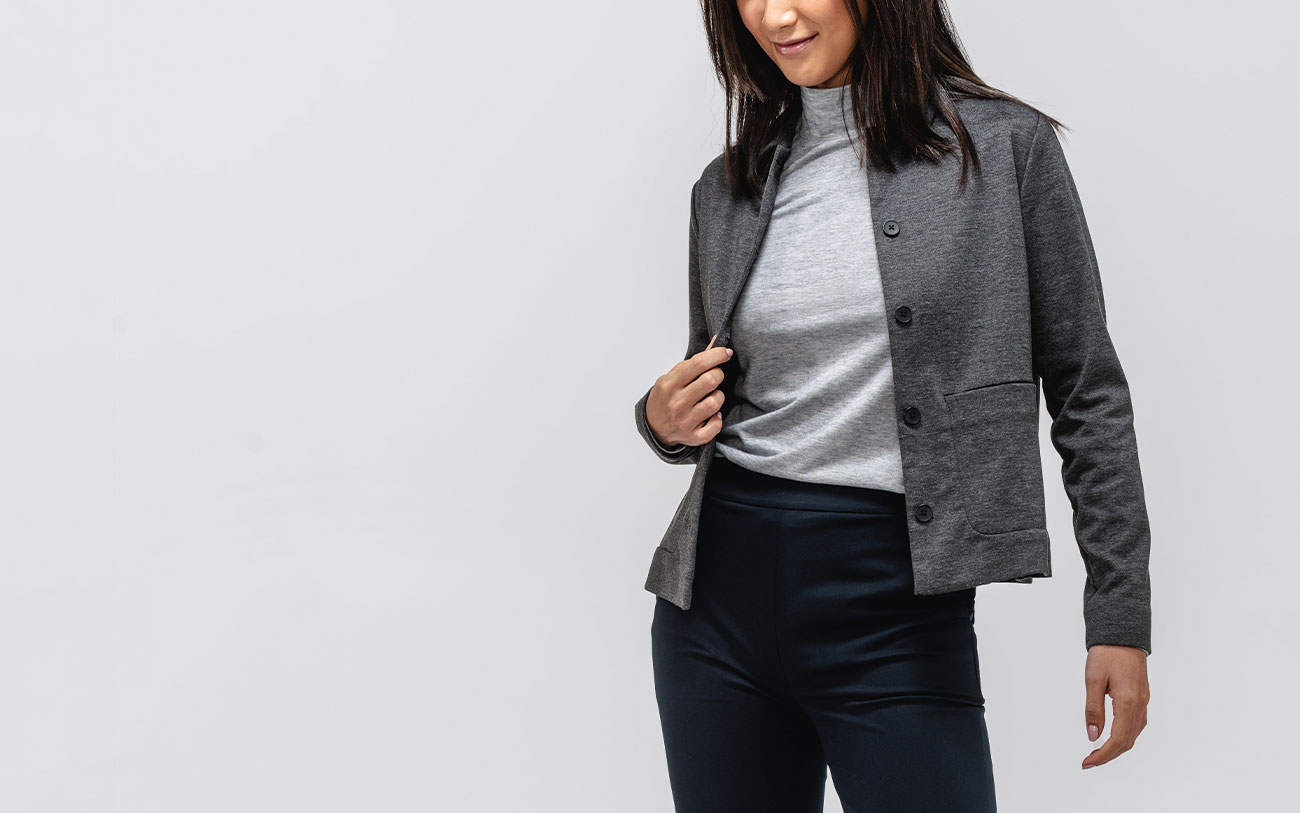 model wearing w's fusion chore coat, composite merino mock neck and kinetic pull-on pant