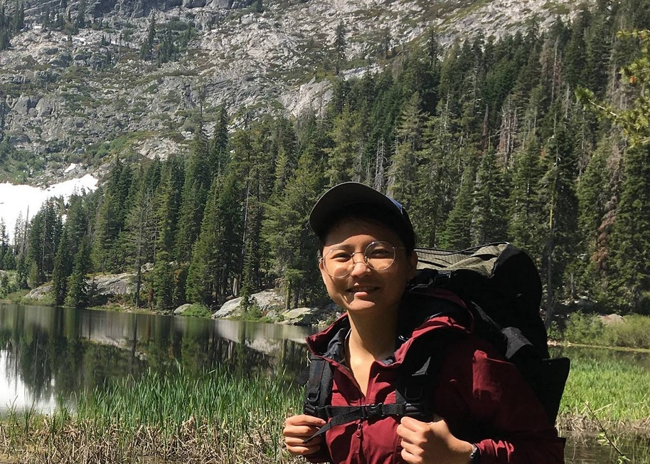 An image of Minh Nguyen, Staff Software Engineer, hiking outdoors.