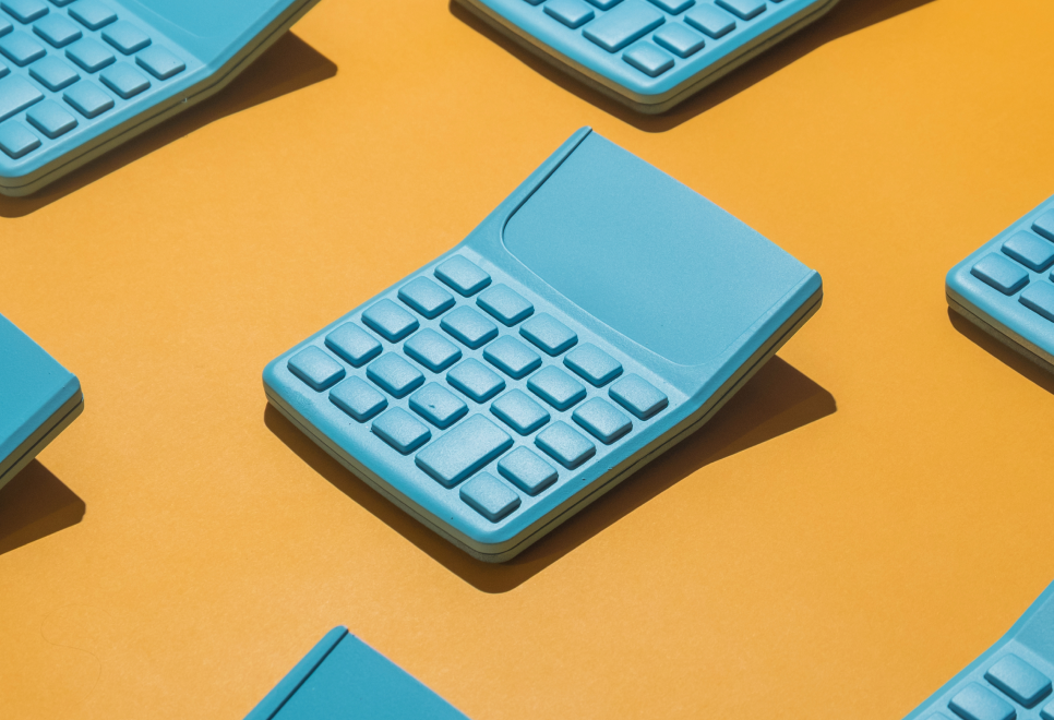 An image of a blue calculator on a yellow background.