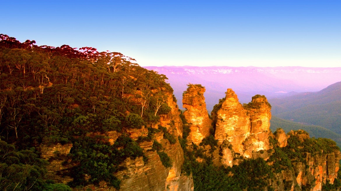 The 3 Sisters rock formations tower over the Jamison Valley in the Blue Mountains
