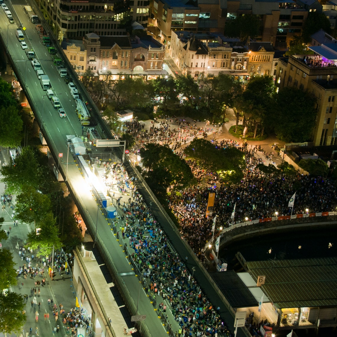 Aerial view of New Year's Eve spectators on the closed Cahill Expressway and spectators packed into the Circular Quay foreshore.