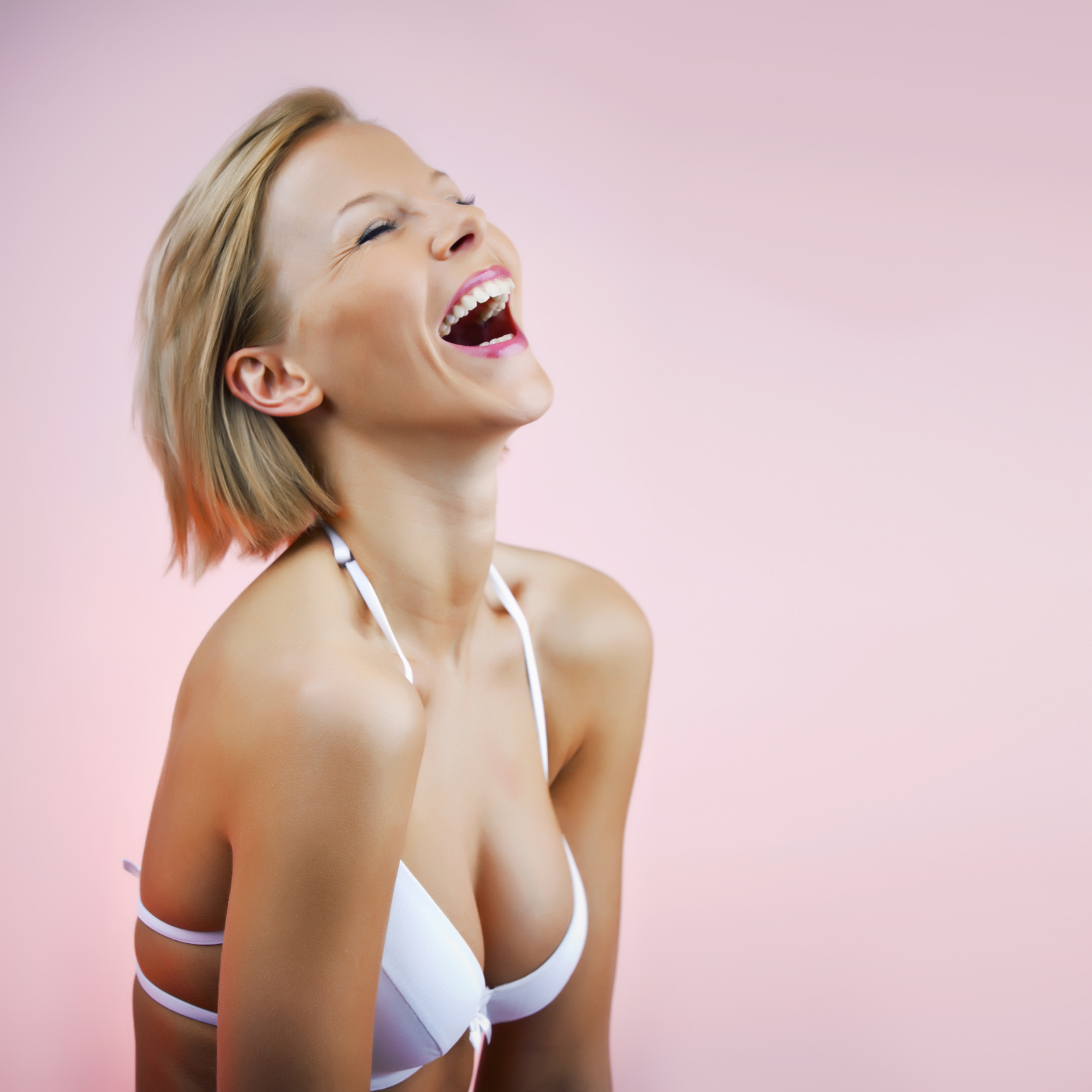 Young cheerful female in a bra