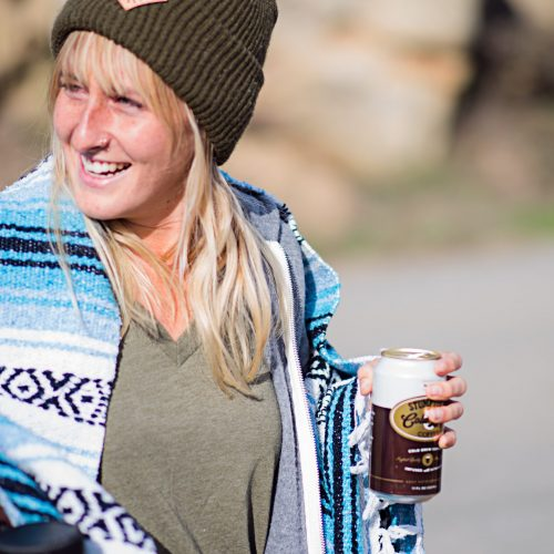 Image of a girl drinking a beer wearing Yellow Belly merchandise