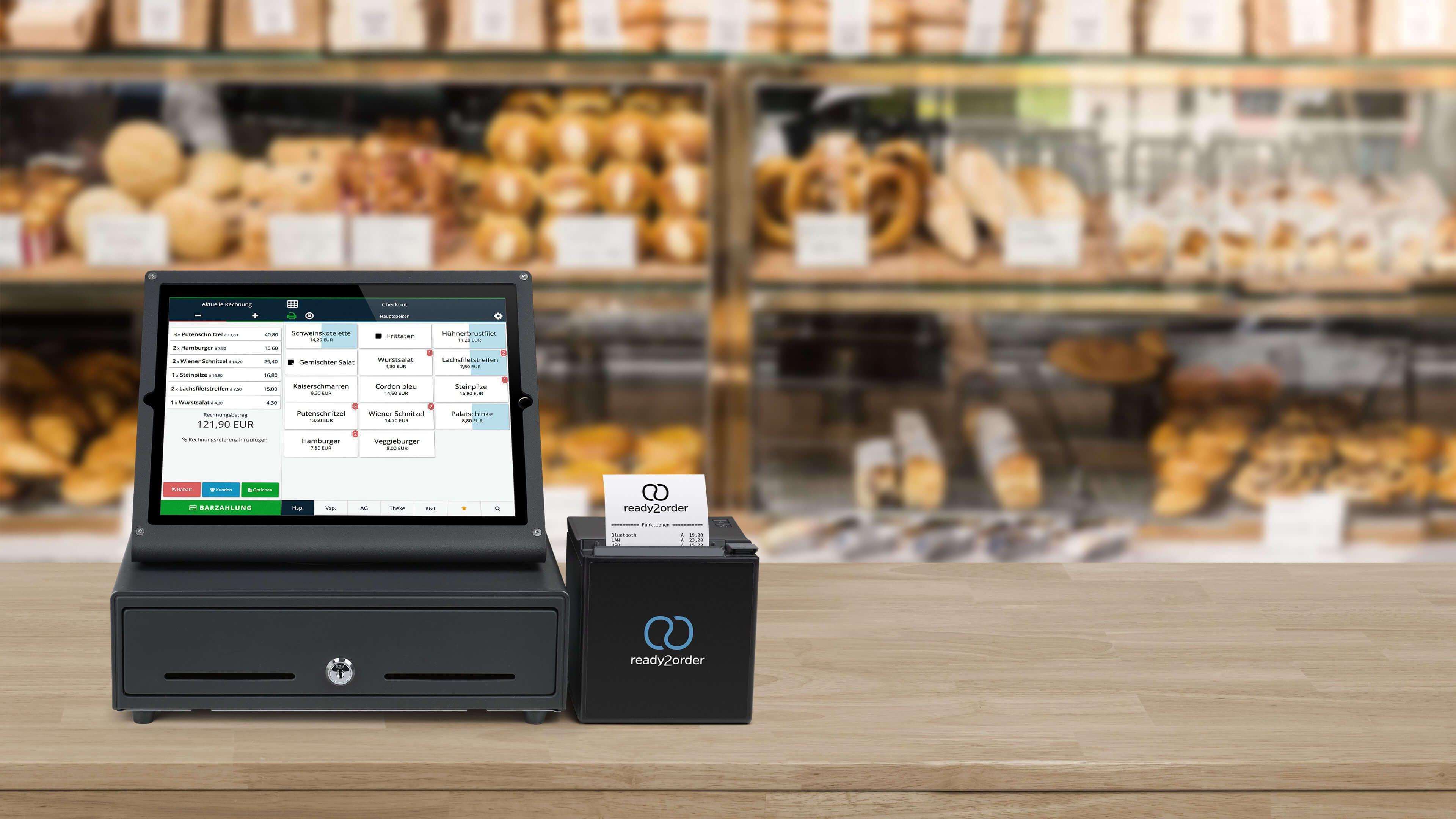 Kassensystem mit Lebensmittel im Hintergrund