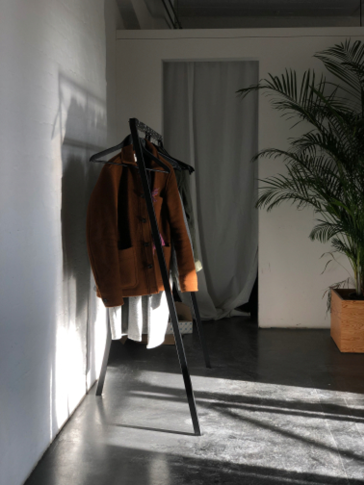 Jackets hanging in the office, hit by sunlight.