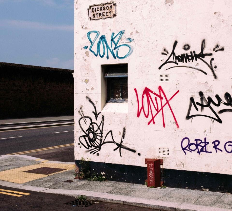Graffiti adorning wall of Dickson Street, close to Pirate Studios Liverpool location