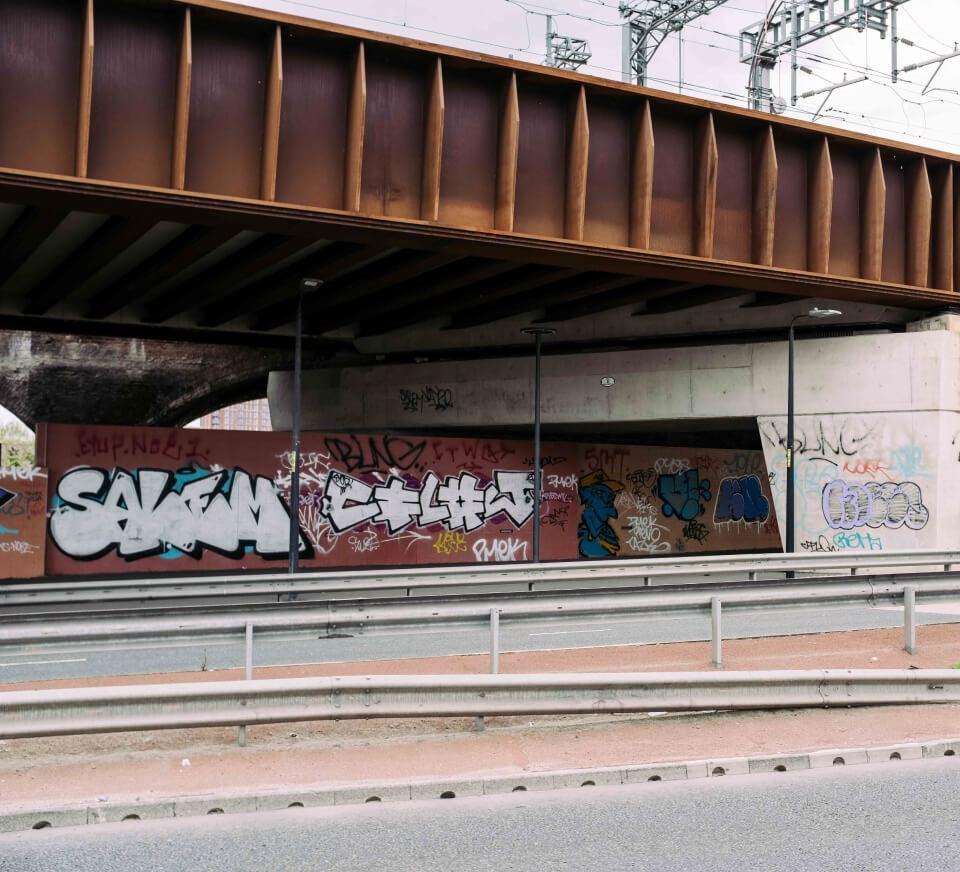 Underside pass covered in graffiti close to Pirate Studios Salford